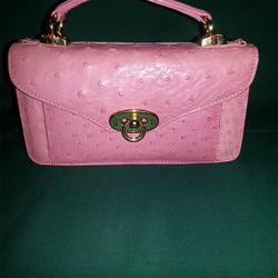 pink crocodile purse